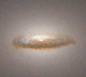 Dust Disk Around a Black Hole in Galaxy NGC 7052 Source: Hubblesite.org